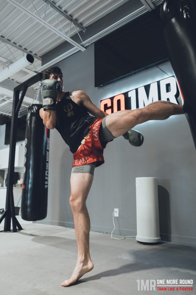 Man kicking in a kickboxing class at one more round in Woodbridge Vaughan